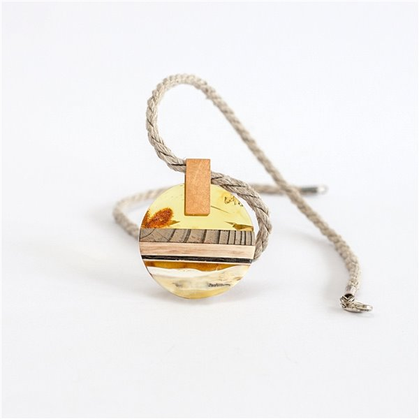 Pendant made of amber and wood on gold plated element.
