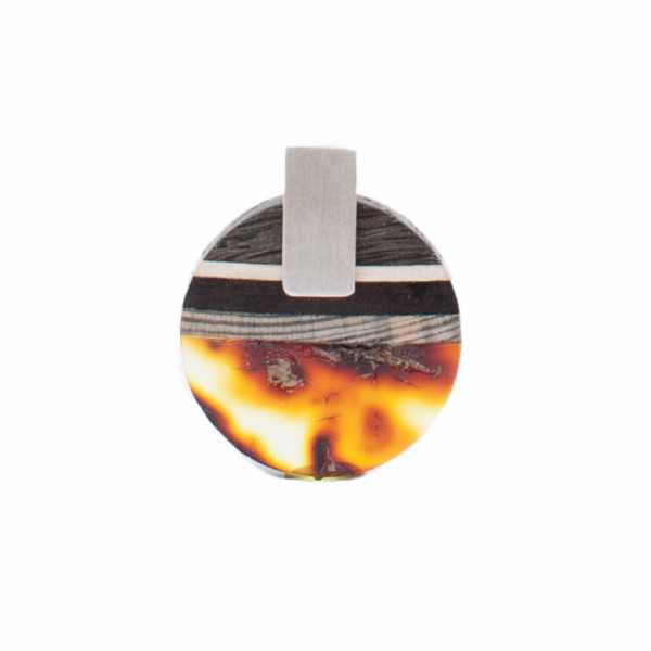Pendant made of amber and wood on silver.