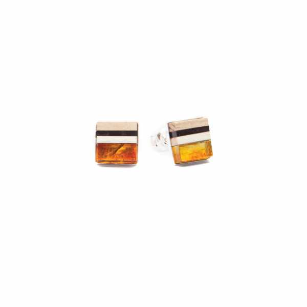 Studs from Simple Collection, made of natural orange amber, wood and Sterling silver.